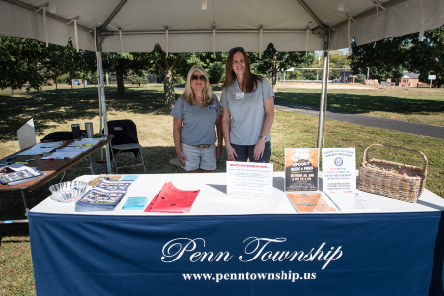 Two members of staff at Penn Township table