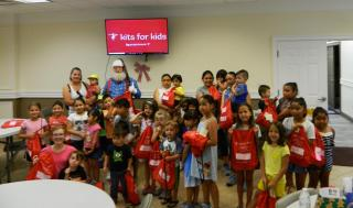 A group of kids with Santa Claus