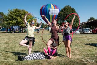 Four people holding hula hoops